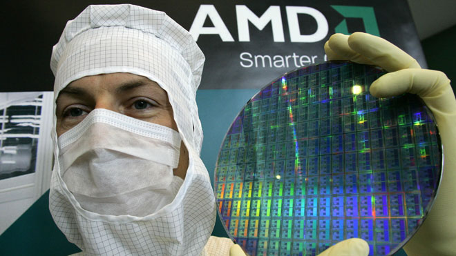 AMD-Technician-Poses-With-Chip-Wafer